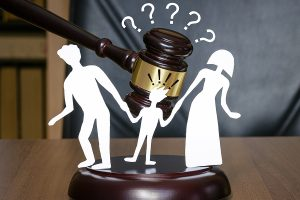 Gavel and parents fighting for custody