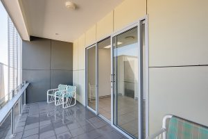 Balcony with smart glass projection rails