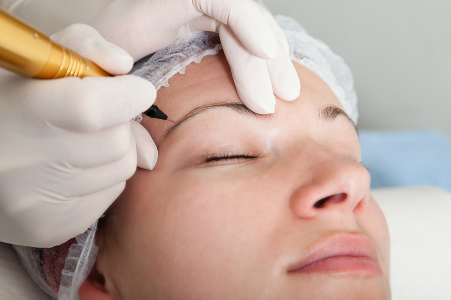 Woman getting a microblading aftercare treatment