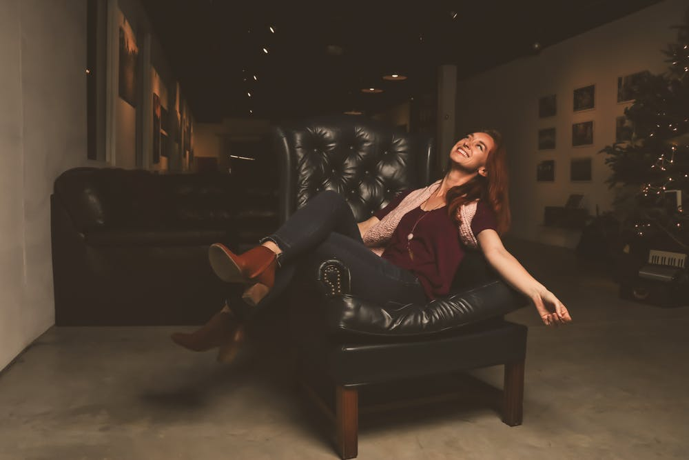 Woman sitting in an authentic Italian furniture