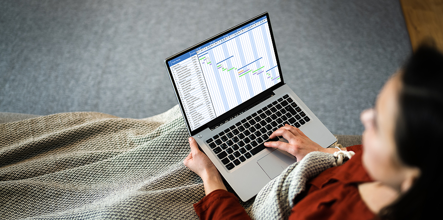 Woman using timesheet application while working from home