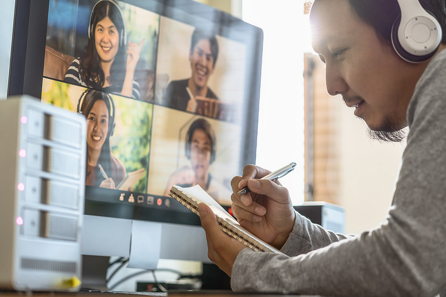 Male worker while video conferencing in Melbourne with his coworkers